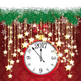 Clock 2017 Snow Fir Twigs Bokeh Golden Curtain Stars. Fir twigs with snow and clock and date 2017 on the red background with ornaments Royalty Free Stock Photos