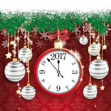 Clock 2017 Snow Fir Twigs Bokeh Gray Baubles. Fir twigs with snow and clock 2017 on the red background with ornaments Royalty Free Stock Photos