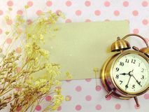 Clock with space backgroun with dried flower decorate Stock Image
