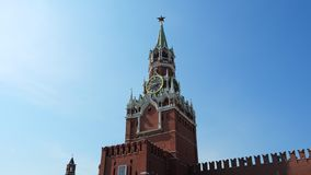 The clock on Spasskaya Tower of the Kremlin against the blue sky on a sunny summer day. Sight of Moscow, the capital of. The clock on Spasskaya Tower of the stock video