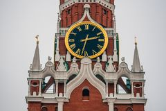 Clock on the Spasskaya tower in red square in Moscow. Russia Stock Photos