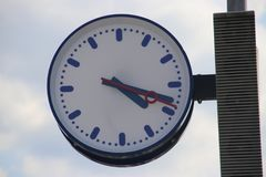 Clock and speaker on a railway station platform in Boskoop, the Netherlands.  stock images