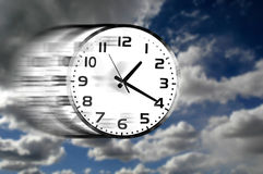 Clock Speeding through Clouds in Blue Sky royalty free stock photo