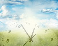 Clock in spring scene. Clock, grass and sky. Spring time Royalty Free Stock Photo