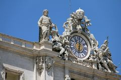 Clock on St. Peter Basilica Stock Image