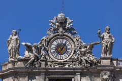 Clock on the St. Peter's facade in Rome, Italy Stock Photos