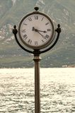 Clock. Standing near the water in italy Stock Photo