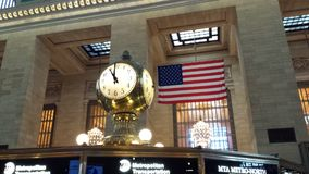 Clock. Station clock and American flag Royalty Free Stock Photo