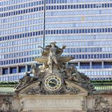 Clock and statue on grand central station in new york city. With office building in the background Stock Photography