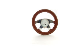 Clock Steering Wheel. An image of a steering wheel shaped clock over white royalty free stock images
