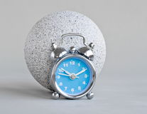 Clock and stone ball Stock Photo