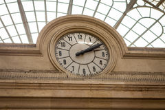 Clock in a stone building facade Royalty Free Stock Photography