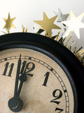 The clock strikes midnight - vertical. The clock about to strike midnight on New Year's Eve royalty free stock photo