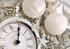 Clock striking midnight Royalty Free Stock Images
