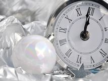 Clock striking midnight Stock Images