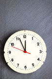 Clock on striped fabric Stock Images