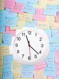Clock surrounded by sticky notes Stock Images