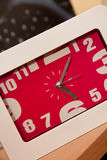 A clock on a table Stock Photo