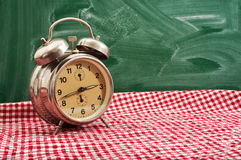 Clock at table Royalty Free Stock Photography