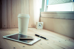 Clock on table with  coffee cup and shutdown tablet, relax time Stock Photos