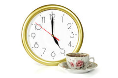 Clock and tea Royalty Free Stock Image