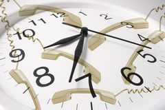 Clock with Telephone Receivers stock images