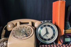 Clock and telephone in the room. Stock Images