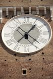 The clock on facade of the Bell Tower in Verona stock photography