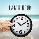 Clock and text earth hour Stock Photo