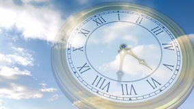 Clock ticking against blue sky stock footage