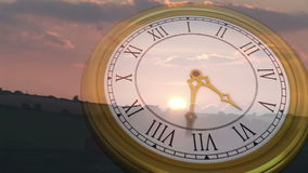 Clock ticking against sun setting stock video