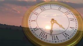 Clock ticking against sun setting. Digital animation of Clock ticking against sun setting stock video