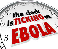 Clock Ticking on Ebola Time Stop Deadly Disease Virus. The clock is ticking on Ebola words to illustrate the fast spread of the deadly disease or virus Stock Photography