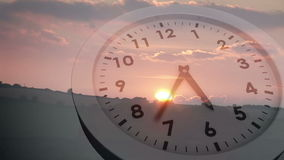Clock ticking over sun setting stock footage