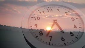 Clock ticking over sun setting. Digital animation of Clock ticking over sun setting stock footage