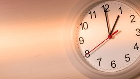 Clock ticking showing one hour Royalty Free Stock Photos