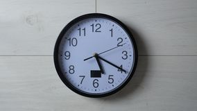 Clock ticking on the wallpapered wall. Clock ticking on wallpapered wall stock video footage