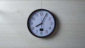 Clock ticking on the wallpapered wall. Clock ticking on wallpapered wall stock footage