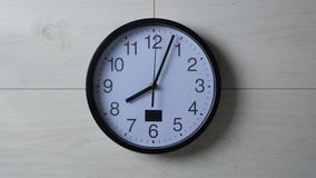 Clock ticking on the wallpapered wall. Clock ticking on wallpapered wall stock video