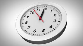 Clock ticking on white background stock footage