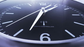 Clock time lapse 4. Time. Closeup of a black office clock royalty free illustration