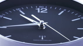 Clock time lapse 1. Time. Closeup of a black office clock royalty free illustration