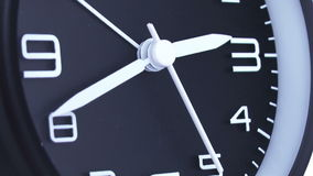 Clock time lapse 5. Time. Closeup of a black office clock stock illustration