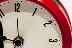 The clock. Time passing on a bright red clock Royalty Free Stock Photos