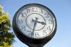 Clock Time. A street clock against a blue sky Stock Images