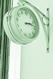 Clock, time. On the wall hang a clock that shows the time Royalty Free Stock Photo