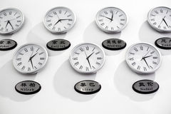 Clock and time zone. This is the international time in the hotel lobby Royalty Free Stock Images