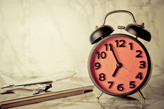 Clock timing the time to board a flight with toy plane on table. With copy space stock photos