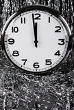 Clock and tinsel Royalty Free Stock Images