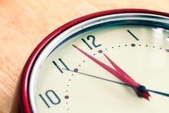 Red alarm clock. On wood Stock Image
